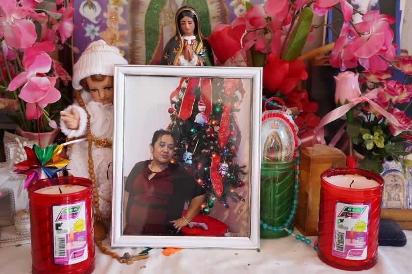 A photo of Maria Irasema Vaquero Lopez, who died of COVID-19 in the U.S., is set up on an altar at her Mexican home.