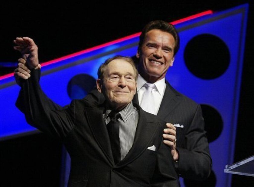FILE - In this March 5, 2005 file photo, California Gov. Arnold Schwarzenegger, right, jokes around with fitness expert Jack LaLanne after presenting LaLanne with the Schwarzenegger lifetime achievement award the finals of the Arnold Classic in Columbus, Ohio. LaLanne, the fitness guru who inspired