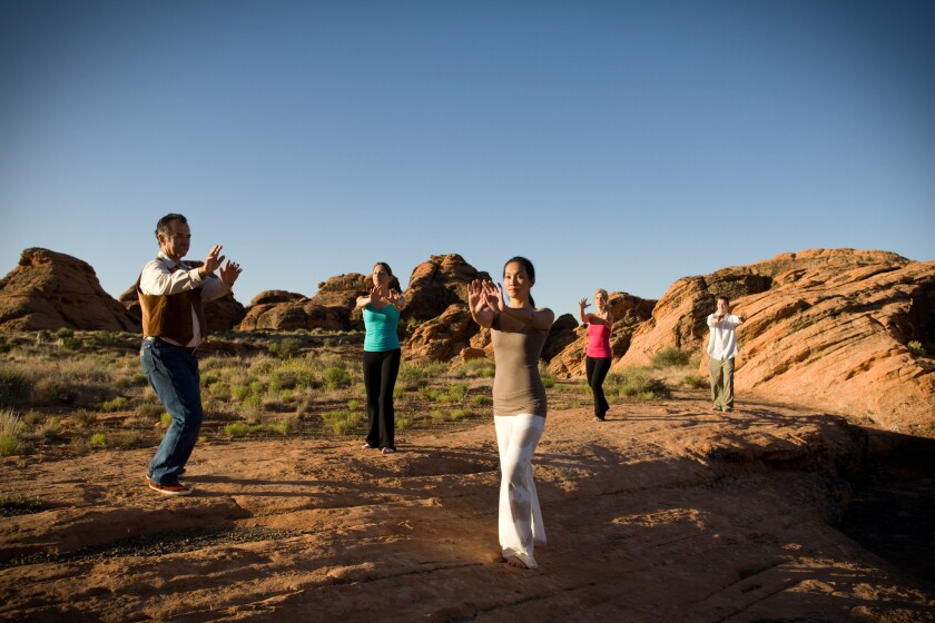The Find Your Park Essential Retreat at Red Mountain Resort includes unlimited classes (like this tai chi session) and healthful meals.