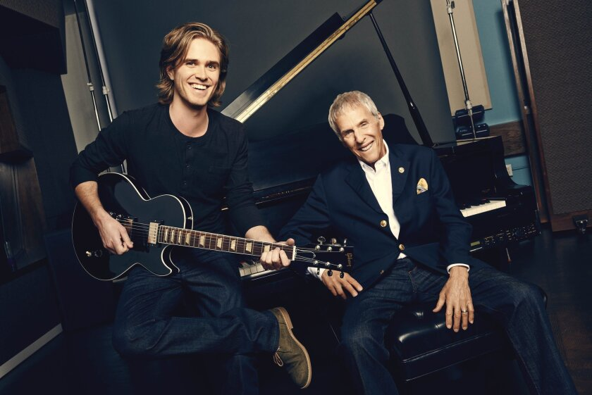"This publicity photo released by Richard Kornberg & Associates for the new musical ""What's It All About? Bacharach Reimagined,"" shows co-conceiver Karl Riabko, left, and composer Burt Bacharach. The show is currently performing off-Broadway at New York Theatre Workshop in New York. (AP Photo/Richard Kornberg & Associates, Eric Ray Davidson)"