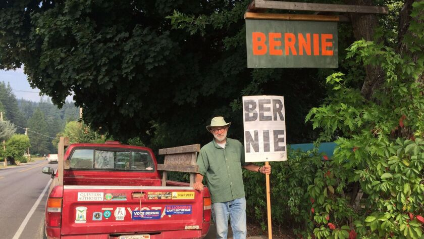 QUINCY CA AUGUST 9, 2017 -- Wayne Cartwright, 70, stands with his homemade Bernie Sanders sign and