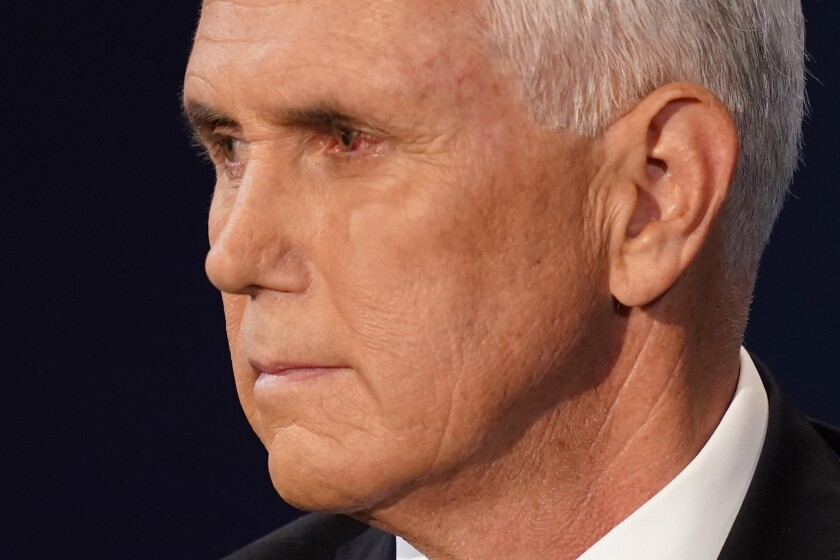 A close view of Vice President Mike Pence's face at Wednesday night's debate shows a reddened left eye.