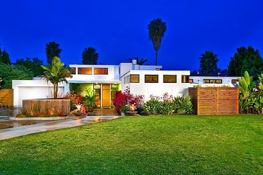 The late-1970s International-style home overlooks the second hole of La Costa's North Course in Carlsbad.