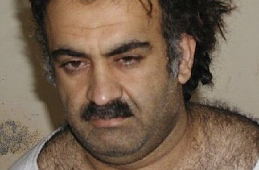 FILE - In this March 1, 2003 file picture, Khalid Sheikh Mohammed is seen shortly after his capture during a raid in Pakistan. A hidden network of American companies headed by a prominent defense contractor played a central role in the CIA's secret post-9/11 airlift that whisked captured terror suspects and their American minders to overseas prisons, according to testimony and documents filed in an upstate New York court case. (AP Photo/File)