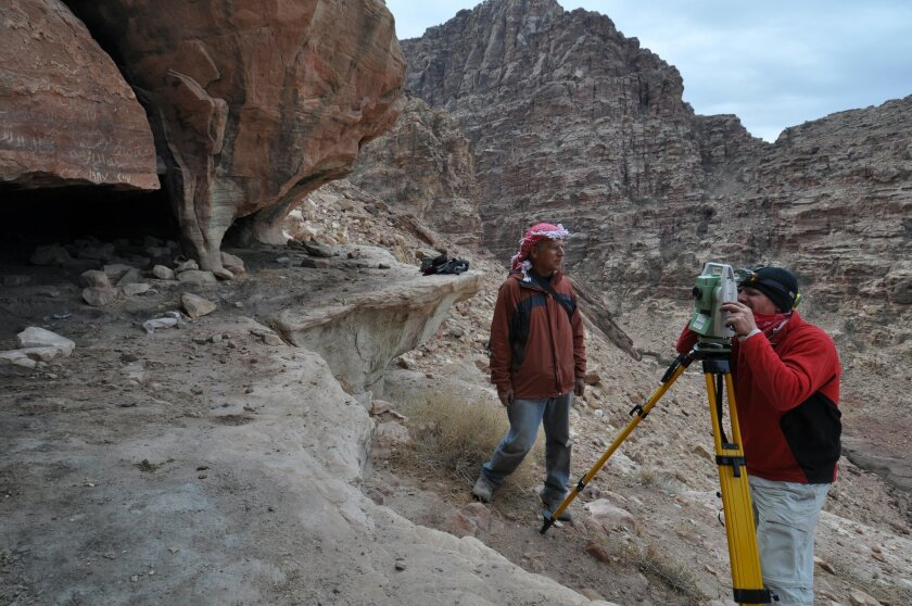 UC San Diego Professor Tom Levy (left) and graduate student Matt Vincent using a reflectorless Total Station to map part of a Roman period mine in Jordan's Faynan district.