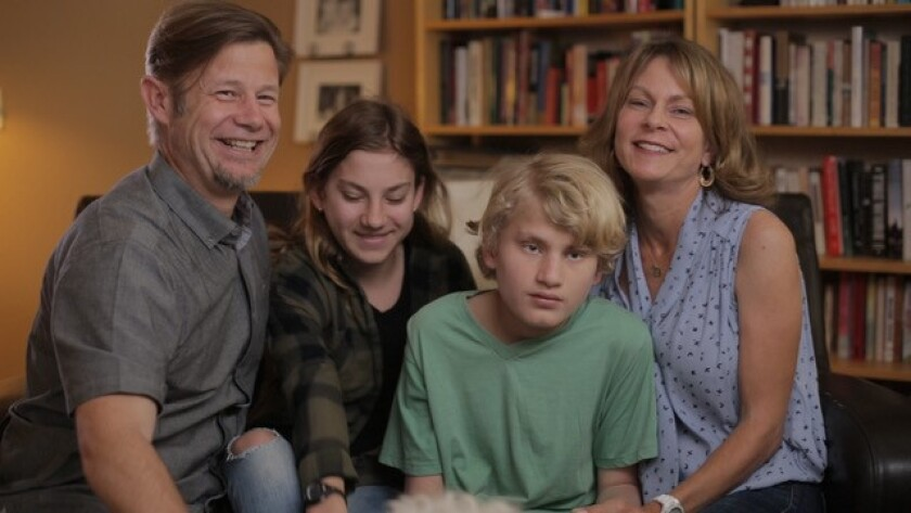 "A scene from the film ""Aging Out"" featuring Carlsbad residents Rob Porter (left), Zoe Porter, Liam Porter and Melissa Collins-Porter, who wrote, directed and produced the documentary about families like her own, who have children, like Liam, with autism."