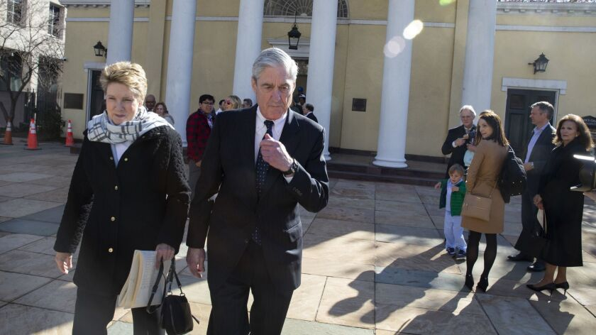 Special counsel Robert S. Mueller III walks with his wife, Ann, on Sunday after leaving church services near the White House.