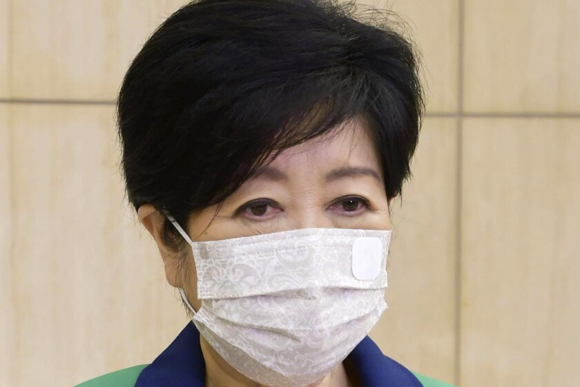 Tokyo Gov. Yuriko Koike speaks to reporters after a meeting on COVID-19 vaccines at the Tokyo Metropolitan Government office in Tokyo Tuesday, June 22, 2021. Koike needs rest due to severe fatigue and will take time off, officials at the Tokyo metropolitan government officials said Wednesday, just one month before the Olympics begin. (Kyodo News via AP)