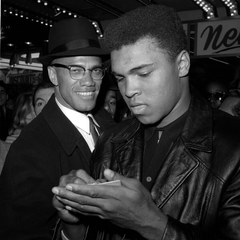 Muhammad Ali, right, is shown with Malcolm X in 1964 in New York.