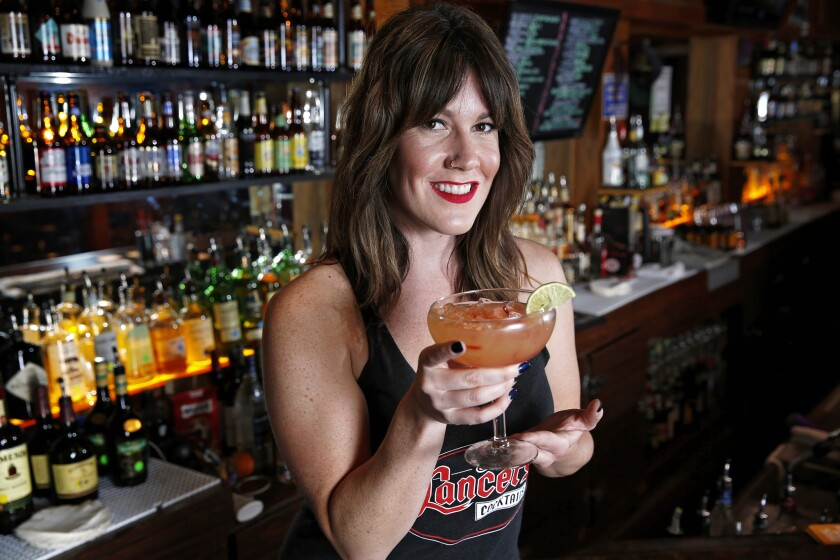Brittney Thompson bartends at Lancers in University Heights.