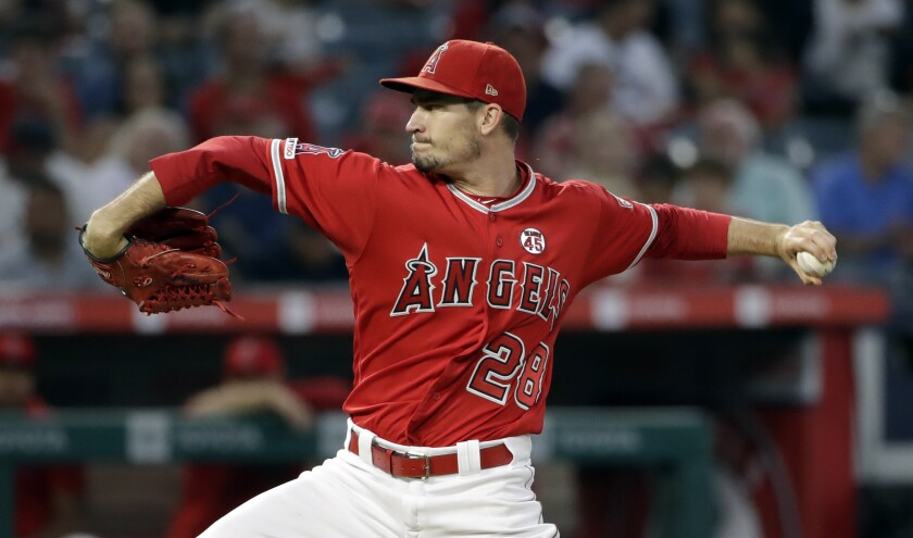 Angels starting pitcher Andrew Heaney throws to a Texas Rangers batter during the second inning on Aug. 27, 2019 at Angel Stadium.