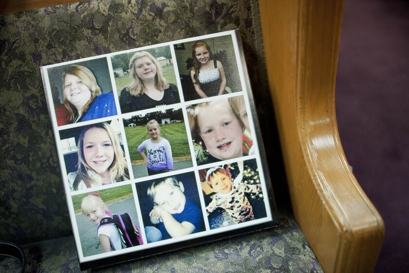 A composite picture of the Watson family is displayed during a service held for them at Calvary Baptist Church in Central City, Ky. Nine members of the Watson family were killed Thursday morning in a house fire.