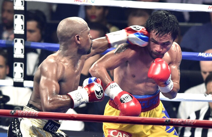 Floyd Mayweather Jr. lands a punch in the eighth round against Manny Pacquiao during their welterweight title fight on May 2, 2015.