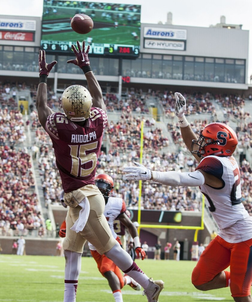 Florida State wide receiver Travis Rudolph goes up for a touchdown catch in the second half of an NCAA college football game against Syracuse in Tallahassee, Fla., Saturday, Oct. 31. Florida State defeated Syracuse 45-21. (AP Photo/Mark Wallheiser)