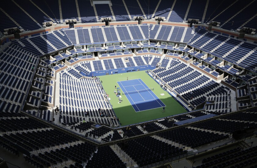FILE - In this Aug. 27, 2017, file photo, players practice for the U.S. Open tennis tournament at Arthur Ashe Stadium in New York. When he first contemplated the prospect of a U.S. Open without fans because of the coronavirus pandemic, the U.S. Tennis Association's chief revenue officer figured there was no way it could work. Lew Sherr eventually came around to embracing the idea of a closed-door Grand Slam tournament -- if it's held at all; a decision is expected in the next two weeks -- because it still could make money even if millions were forfeited with zero on-site receipts from tickets, hospitality, food and beverage or merchandise sales. (AP Photo/Peter Morgan, File)
