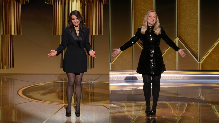 hosts Amy Poehler and Tina Fey