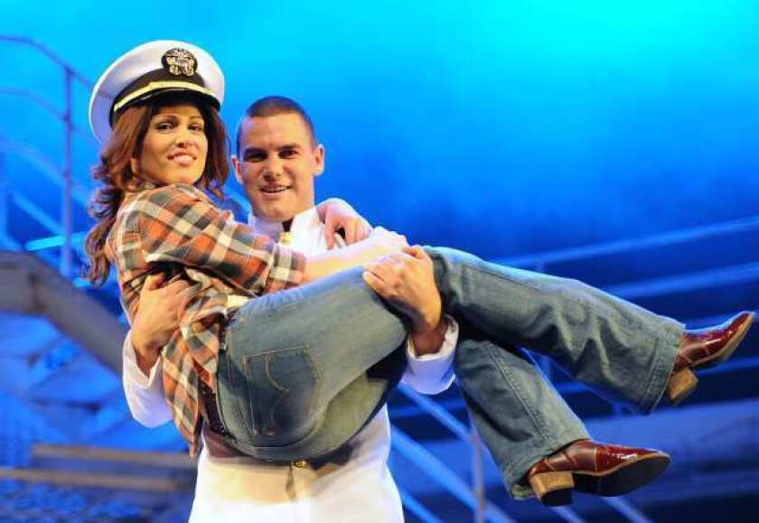 """Amanda Harrison and Ben Mingay in a scene from the stage musical """"An Officer and a Gentleman"""" at the Lyric Theatre in Sydney, Australia."""