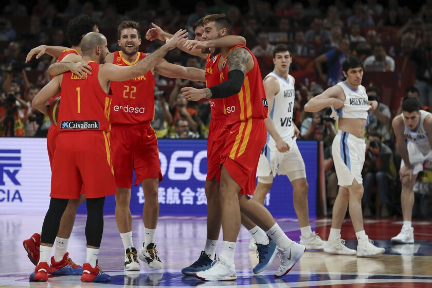 Spanish players celebrate after defeating Argentina in the FIBA Basketball World Cup final Sunday in Beijing.