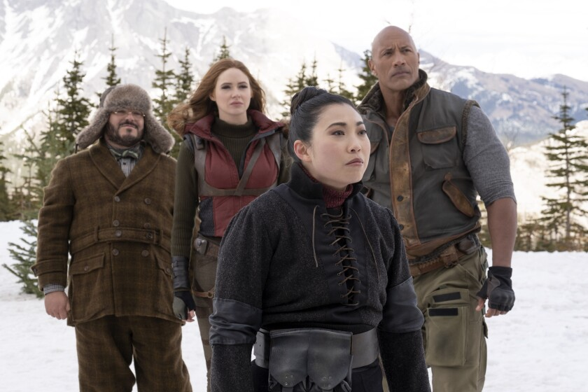 "Jack Black, Karen Gillan, Awkwafina and Dwayne Johnson in ""Jumanji: The Next Level."""