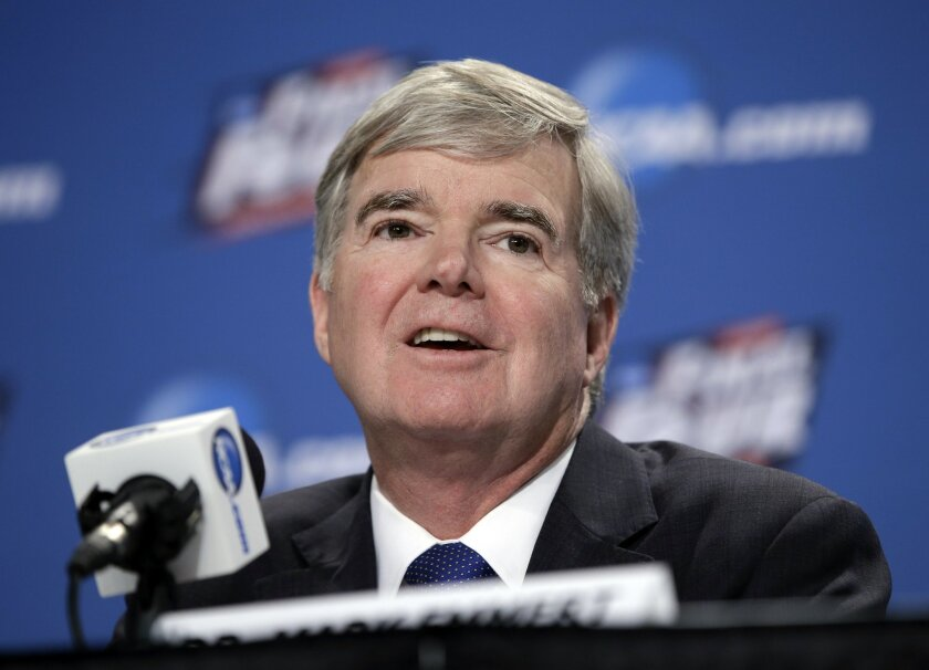 FILE - In this April 2, 2015, file photo, NCAA President Mark Emmert answers questions during a news conference at the Final Four college basketball tournament in Indianapolis. Emmert believes mid- and lower-level members are gradually adjusting to Power Five conference school's autonomy and increa