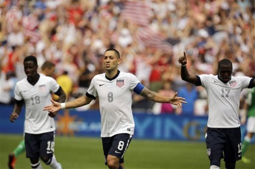 U.S. forward Clint Dempsey (8) celebrates his second goal with U.S. forwards Eddie Johnson (18) and Jozy Altidore (17) during the second half of an international friendly soccer match against Germany at RFK Stadium, Sunday, June 2, 2013, in Washington. The U.S. won 4-3. (AP Photo/Alex Brandon)