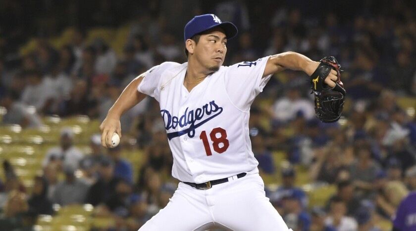 Dodgers reliever Kenta Maeda delivers against the Rockies.