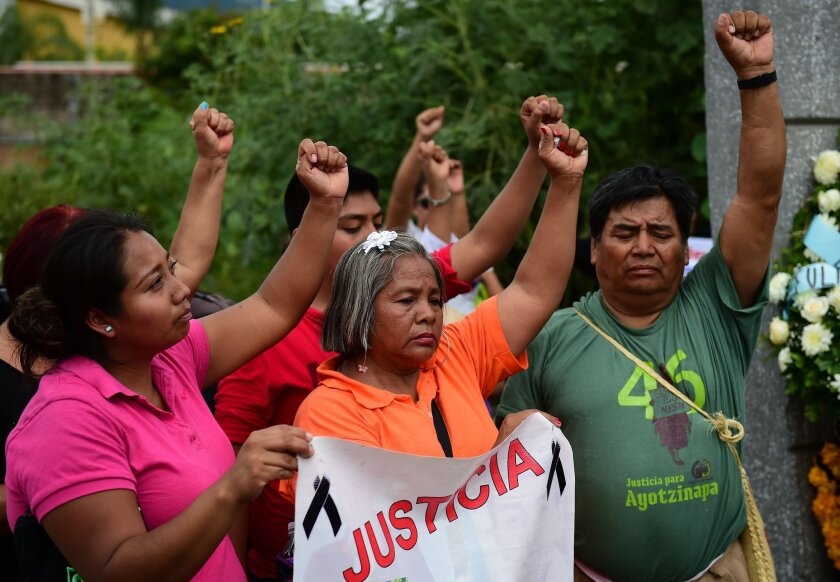 Relatives and friends of 43 missing students in Mexico demonstrate in Iguala, Guerrero state, on Sept. 27 to commemorate the first anniversary of their disappearance.