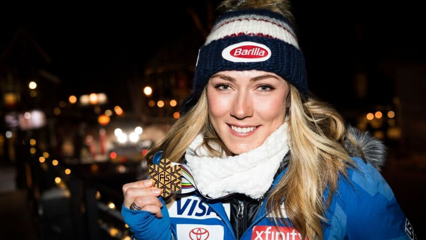 Mikaela Shiffrin poses for a photo after the medals ceremony for the super-G competition at the world championships.