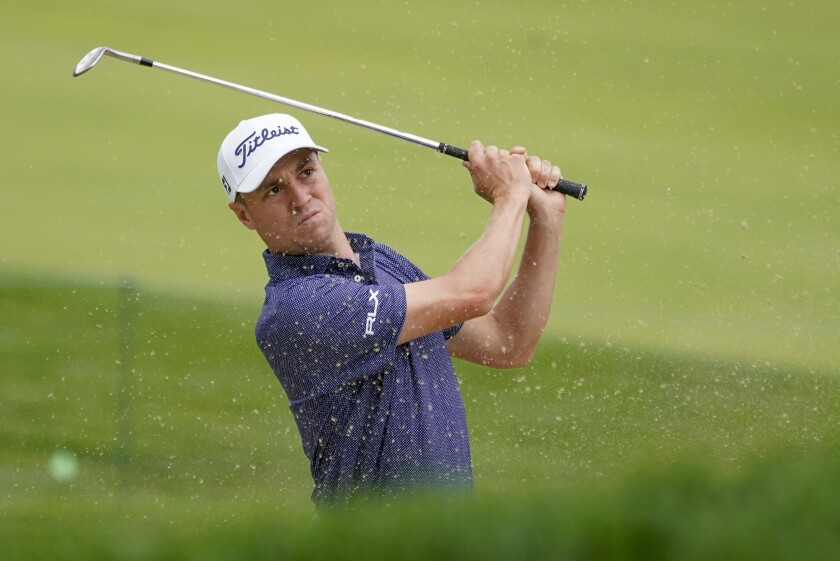 Justin Thomas hits out of the bunker on the 17th hole during the first round of the U.S. Open on Thursday.