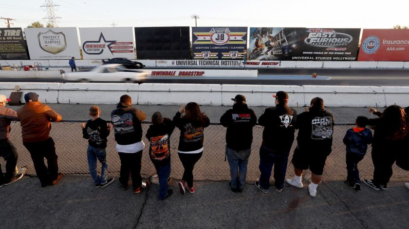 IRWINDALE, CALIF. - APR. 19, 2018. Spectatros watch drag races at the Irwindale Speedway in Irwinda