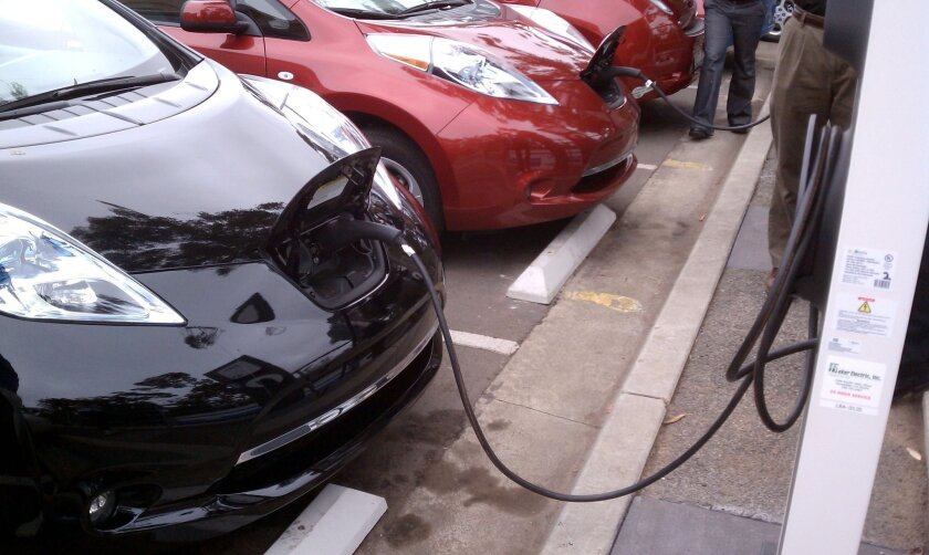 Nissan LEAFs charge outside the Reuben H. Fleet Science Center in Balboa Park. Ten electrical vehicle charging stations have been installed in Balboa.