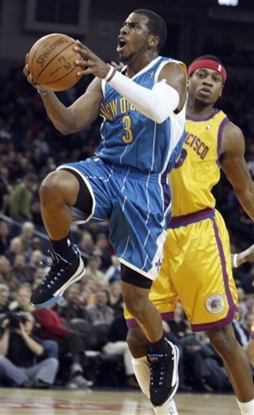 New Orleans Hornets' Chris Paul (3) lays up a shot past Golden State Warriors' Cartier Martin during the first half of an NBA basketball game Wednesday, Jan. 27, 2010, in Oakland, Calif. (AP Photo/Ben Margot)