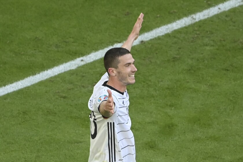 Germany's Robin Gosens after scoring his side's fourth goal during the Euro 2020 soccer championship group F match between Portugal and Germany at the football arena stadium in Munich, Saturday, June 19, 2021. (Matthias Hangst/Pool Photo via AP)