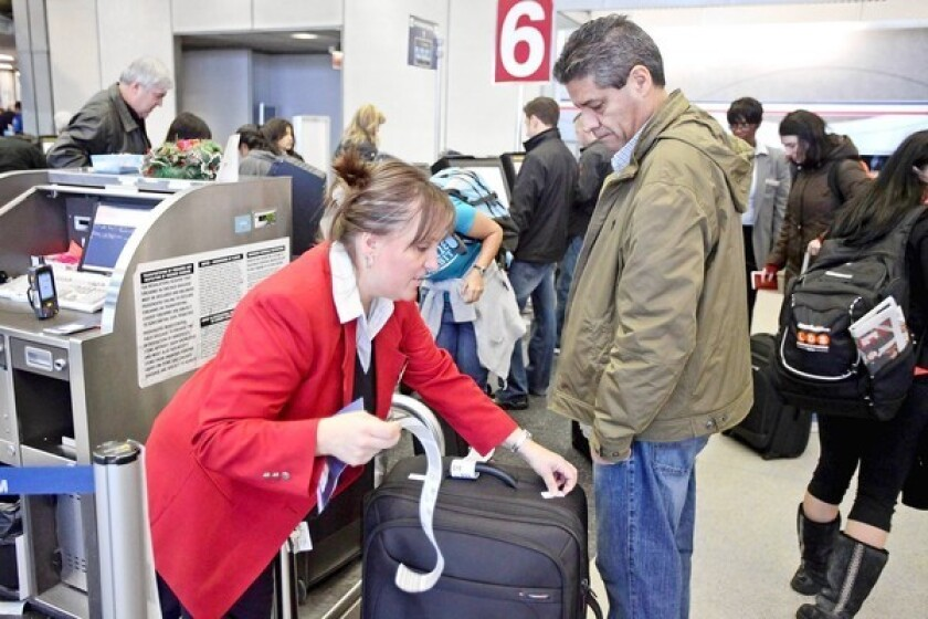 About 3% of all bags that are mishandled are stolen or lost. Above, a traveler receives assistance from an American Airlines representative at O'Hare International Airport in Chicago.