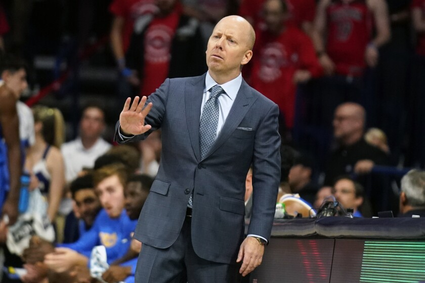 UCLA coach Mick Cronin gestures to his players during the second half against Arizona on Saturday.