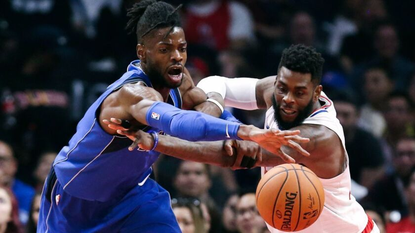 Dallas Mavericks center Nerlens Noel, left, and Clippers forward Willie Reed fight for a ball during the first half on Wednesday.