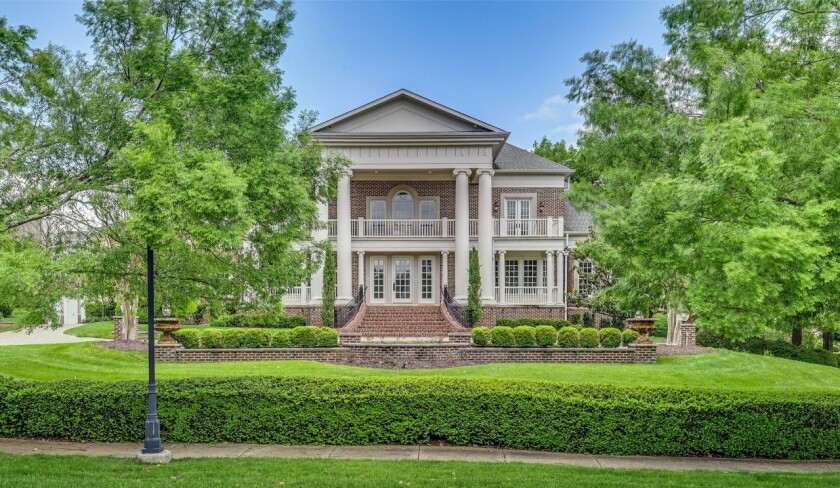 The three-story brick mansion boasts seven bedrooms and 10 bathrooms in about 12,000 square feet.