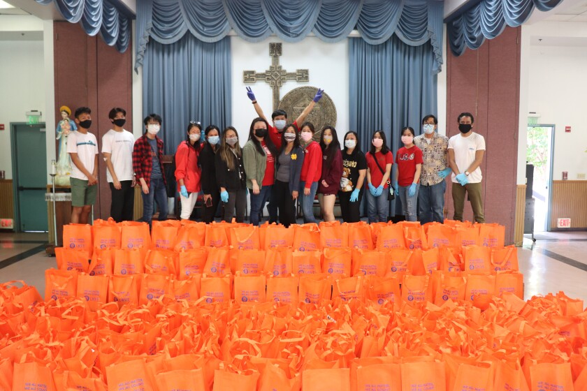 Community volunteers prepared and distributed gifts for senior fathers on Father's Day in 2020.