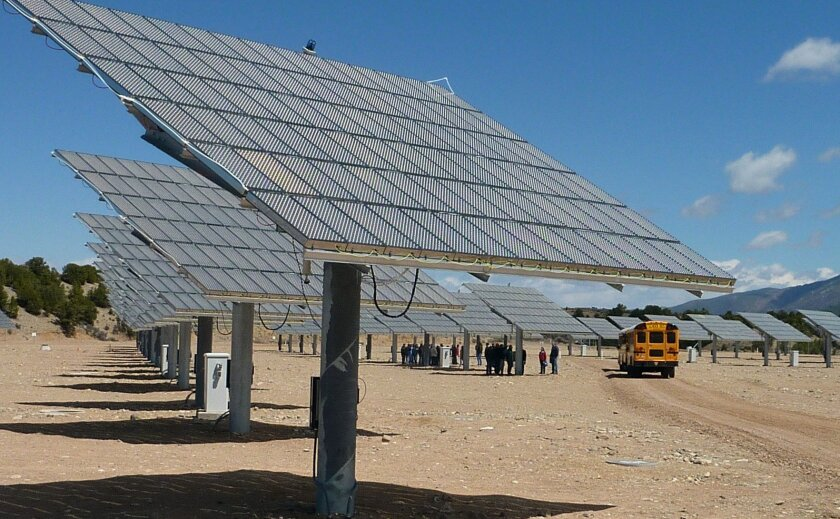 Schoolchildren from Questa, N.M., check out a new solar farm built by Soitec, a French company proposing to make similar panels in San Diego.