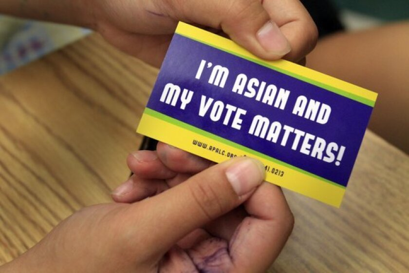 """Workers with the Asian Pacific American Legal Center handed out stickers that read: """"I'm Asian and My Vote Matters."""" President Obama did spectacularly well with Asian Americans, garnering nearly three-quarters of their vote."""