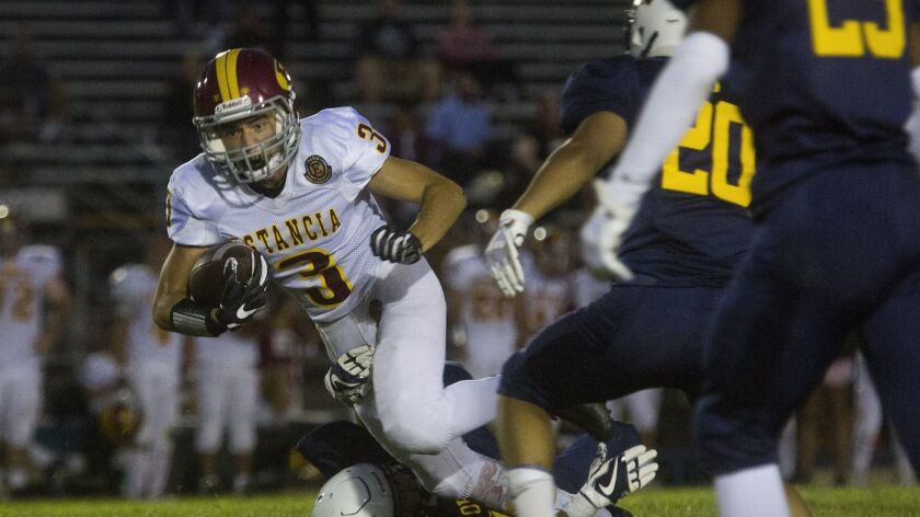 Estancia's Nathan Guyot pushes past La Quinta's defense for a first down during a non-league game at