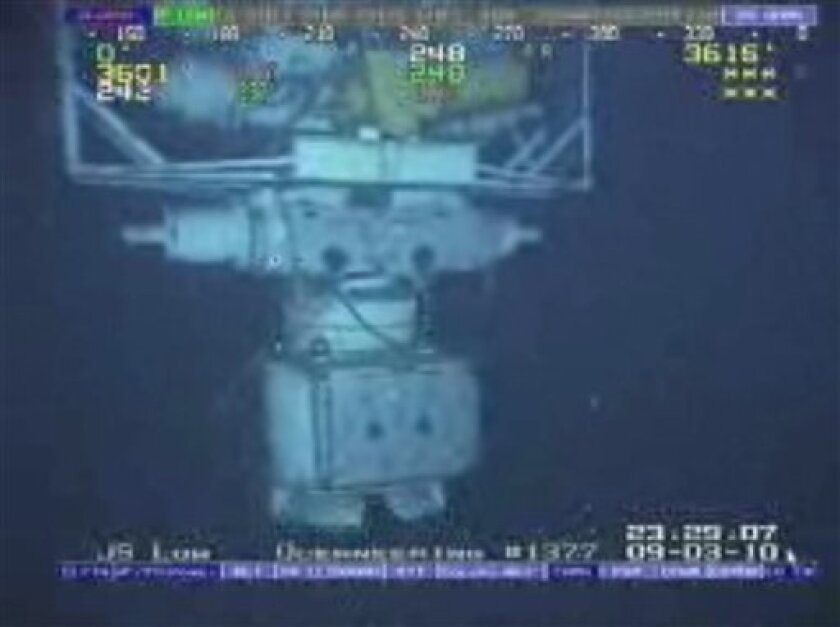 In this image taken from video provided by BP PLC at 12:23 a.m. EDT, Saturday Sept. 4, 2010 Aug. 3, 2010 shows the blowout preventer that failed to stop oil from spewing into the Gulf of Mexico being raised to the surface. The blowout preventer wasn't expected to reach the surface until Saturday, at which point government investigators will take possession of it. (AP Photo/BP PLC) NO SALES