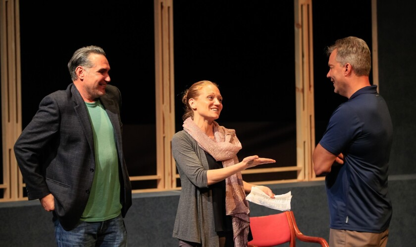 "Director Christy Yael-Cox (center) works with actors Daren Scott (left) and Jason Heil during a rehearsal for Intrepid Theatre's ""Art."""