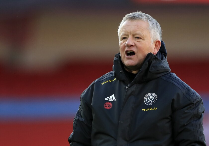 Sheffield United's manager Chris Wilder gives instructions to his players during a warm up before the English Premier League soccer match between Sheffield United and West Ham United at Bramall Lane stadium in Sheffield, England, Sunday, Nov. 22, 2020. (Mike Egerton/Pool via AP)