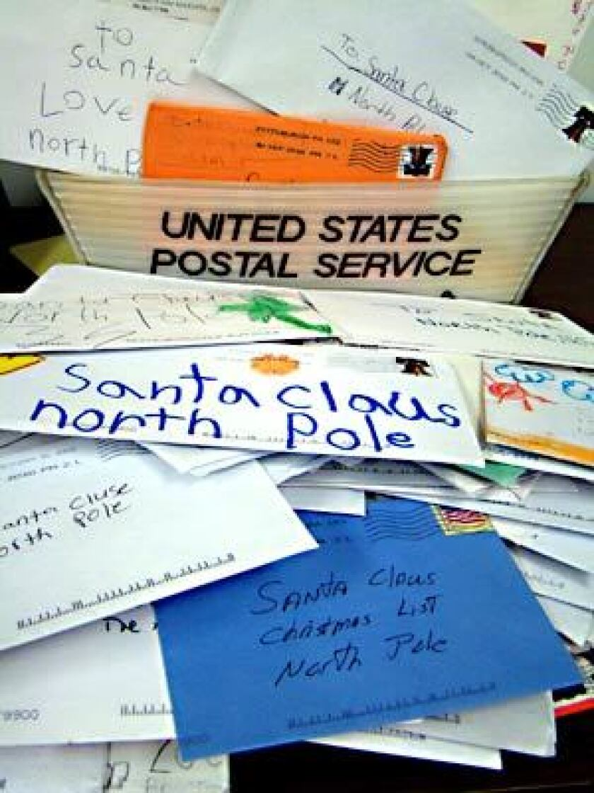 Tens of thousands of letters addressed to Santa Claus are answered each year by volunteers.