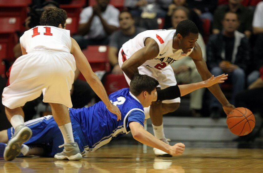 James Rahon (left) and Xavier Thames try to get a loose ball as Creighton's Doug McDermott lunges for it in the first half.