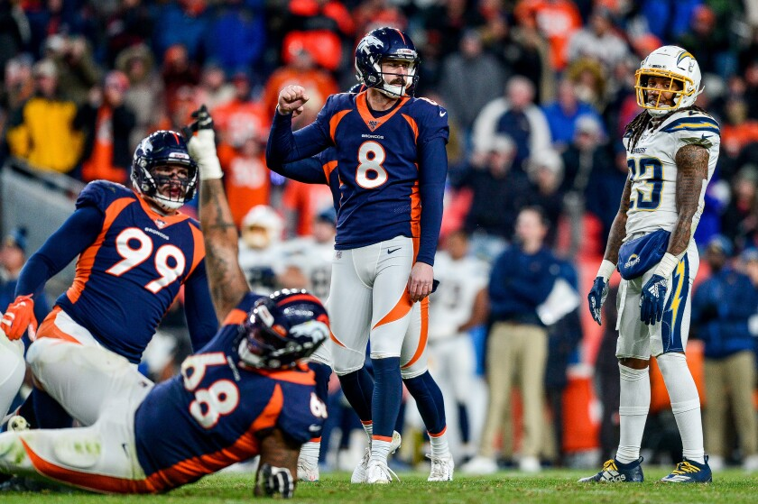 Brandon McManus (8) of the Denver Broncos celebrates after kicking a game-winning 53-yard field goal as time expires in the fourth quarter of a game against the Los Angeles Chargers at Empower Field at Mile High on Sunday in Denver.
