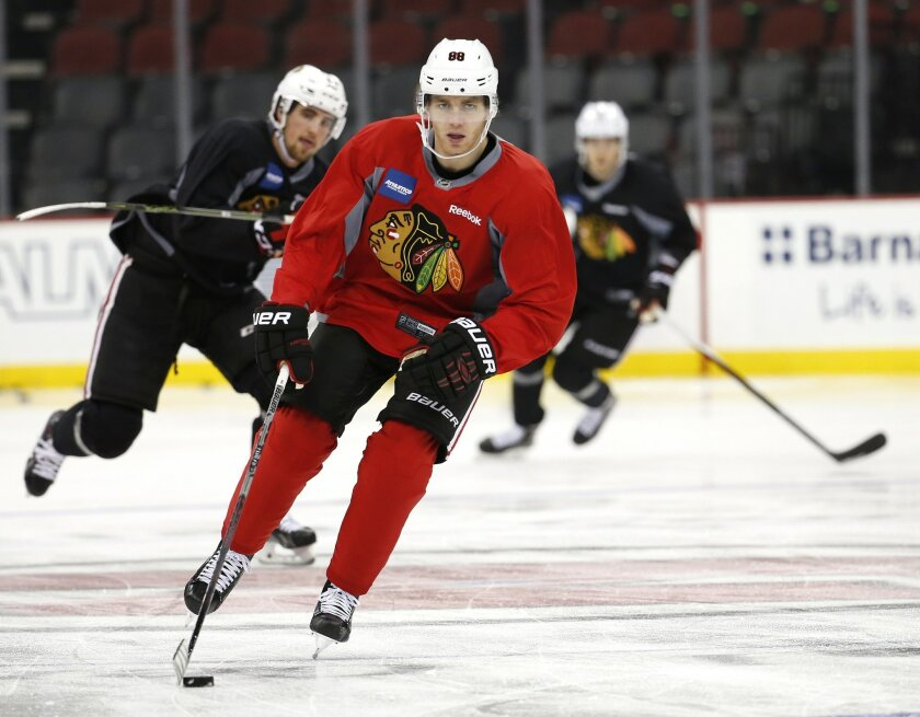 Chicago Blackhawks' Patrick Kane works out during a morning skate prior to facing the New Jersey Devils, Friday, Nov. 6, 2015, in Newark, N.J. Prosecutors announced Thursday, Nov. 5, 2015, that they will not bring rape charges against Kane, citing a lack of credible evidence and the accuser's decis
