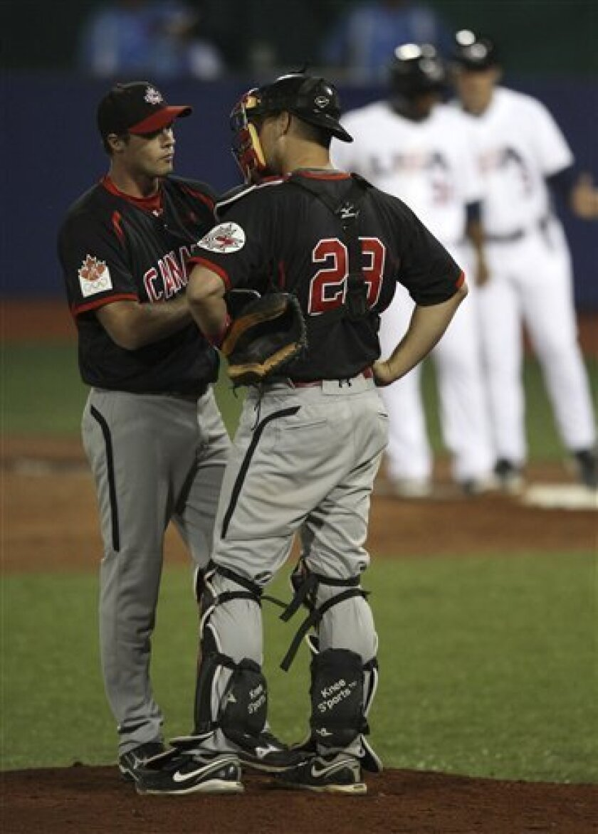 Canada catcher Cole Armstrong, right, talks in the mound with his starting pitcher Andrew Alberts during the third inning of the final baseball game against the United States at the Pan American Games in Lagos de Moreno, Mexico, Tuesday Oct. 25, 2011. (AP Photo/Javier Galeano)