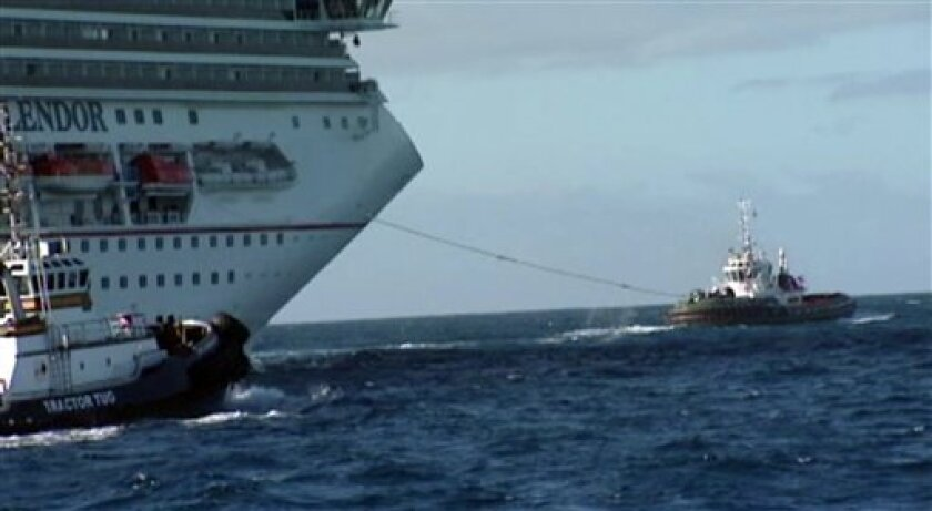 In this image taken from video, tug boats pull the disabled cruise ship Carnival Splendor toward the U.S. Wednesday, Nov. 10, 2010. The boat is expected to dock in San Diego midday Thursday. (AP Photo/APTN)